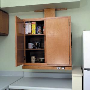 Upper kitchen cabinet lowered close to counter height